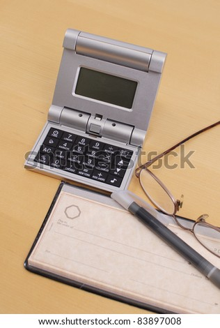Calculator with Checkbook on Desk