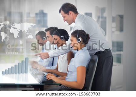 Call center employees at work on futuristic interfaces showing map and graph with supervisor in the office