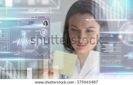 Calm doctor touching a medical interface in the hospital