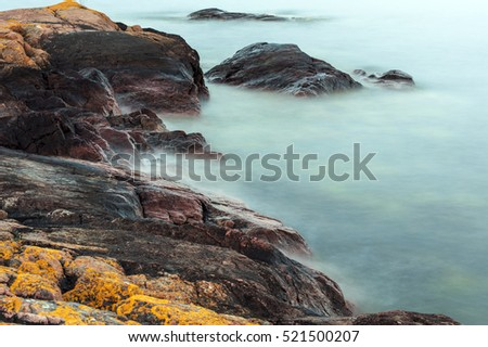 Calm water and rocks, long exposure