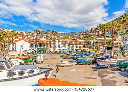 Camara de Lobos, Madeira - June 8, 2013: Port with fishing boats. The village is typical for its cat shark drying under the sun.