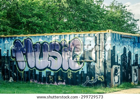 CAMBRIDGE, ENGLAND - 7th MAY 2015: Graffiti on a building depiction of music