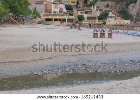 CAMP DE MAR, MAJORCA, SPAIN - OCTOBER 30 2013: Deep erosion damage in the beach sand on October 30, 2013, in Camp de Mar, Majorca, the day after the big mcs-type thunderstorm of October 29 2013.