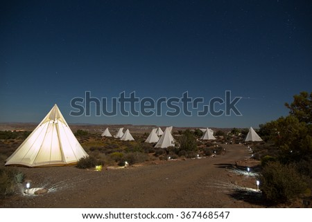 Campground in the desert near Moab, Utah under a clear sky.