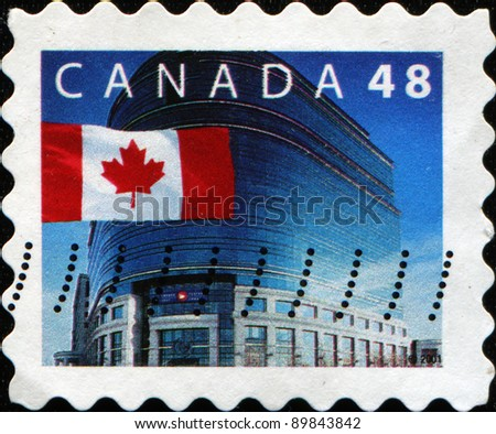 CANADA - CIRCA 2010: A stamp printed in Canada honoring Vancouver wins bid for Winter Olympics shows Canadian flag, circa 2010