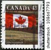 CANADA - CIRCA 1992: A stamp printed in Canada shows Canadian flag and Prairie, circa 1992 - stock photo
