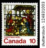 """CANADA - CIRCA 1976: A stamp printed in Canada shows Nativity, Stained-glass Window, St. Jude, London, with the inscriptions """"Christmas"""", from the series """"Christmas"""", circa 1976 - stock photo"""