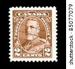 CANADA - CIRCA 1935: Two cent Canadian mail stamp featuring a portrait of King George V, circa 1935 - stock