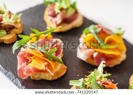 Panasian food dish panasian cuisine on stock photo for Canape bread tubes