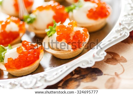Round crackers cream dill salmon plate stock photo for Canape with caviar