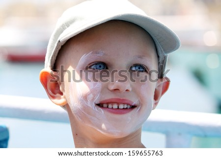 cancer child with sun cream on her face