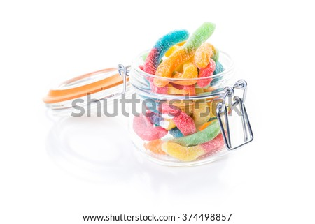 Candies in candy jar on a white background.