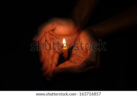 Candle light in hand, Pray to God concept
