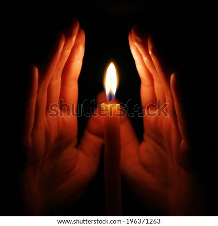 Candle light with hands.