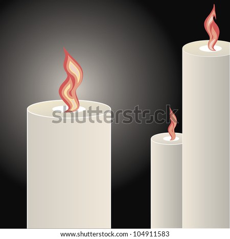 Candles burning bright over a black background