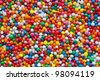 Candy sprinkles, in full-frame background.  Colorful hundreds and thousands or nonpareils. - stock photo