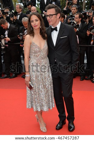 "CANNES, FRANCE - MAY 14, 2016: Actress Berenice Bejo & husband director Michel Hazanavicius at the gala premiere for ""The BFG"" at the 69th Festival de Cannes."