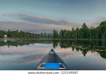 Canoeing on a calm lake in the morning