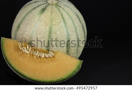 cantaloupe melon on black background