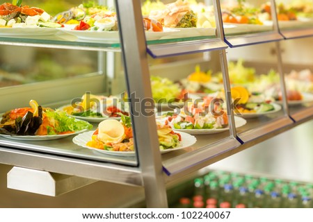 Canteen self-service food display plate with fresh made salad
