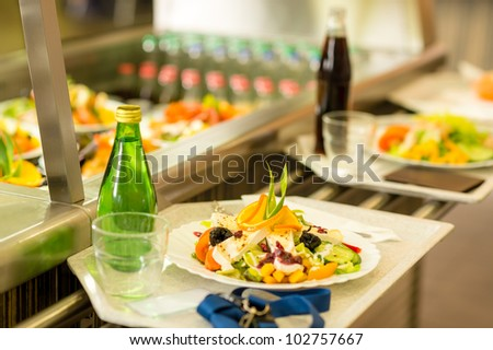 Canteen serving tray healthy fresh salad cafeteria lunch food self-service