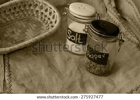 capacity for salt and pepper on linen background basket