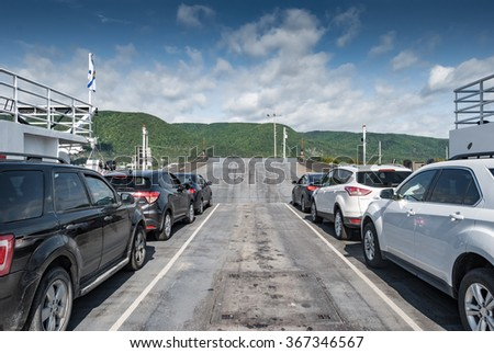 CAPE BRETON, CANADA - SEP 15, 2015: Cars on the Englishtown ferry head towards the Cabot Trail