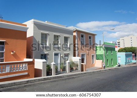 Upscale Pastel Strip Mall Building Red Stock Photo