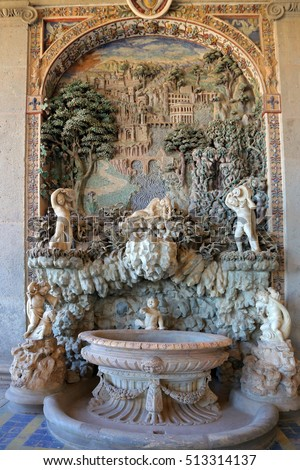 CAPRAROLA, ITALY - OCTOBER 16, 2016: Palazzo Farnese rustic fountain in Loggia of Hercules, made mosaic and polychrome stucco in which are represented some possessions of the Farnese.