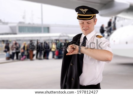Captain waiting for passengers boarding