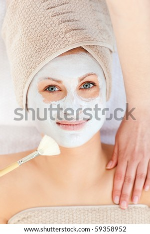 Captivating woman receiving a beauty treatment in a spa center