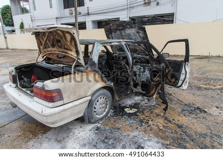 Car burned,After burn car fire suddenly started engulfing all the car,Car on fire after and accident or during a riot.