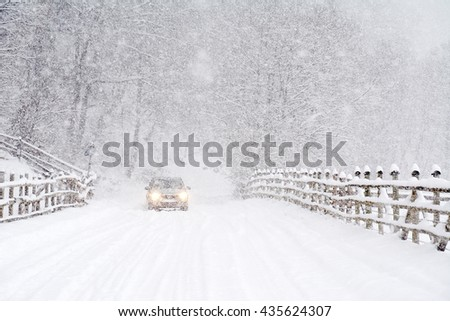 Car driving on a heavy winter road