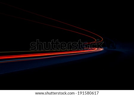 Car light trails. Art image . Long exposure photo taken in a tunnel