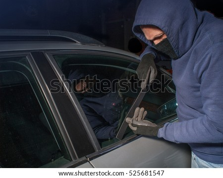 Car thief looking to open a locked vehicle