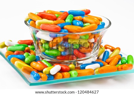 caramel colored capsules, filled licorice