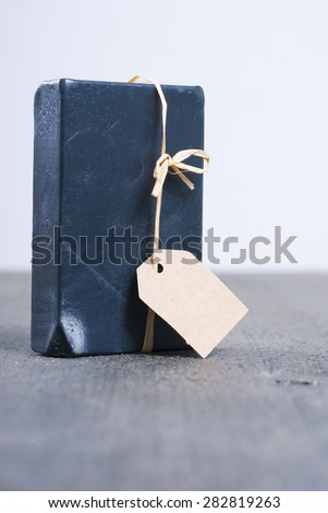 carbon soap with empty gift card on dark wooden table