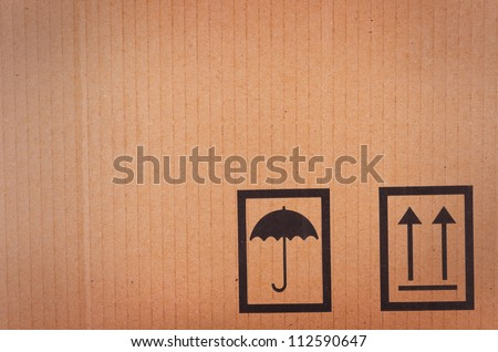 Cardboard background with shipping icons