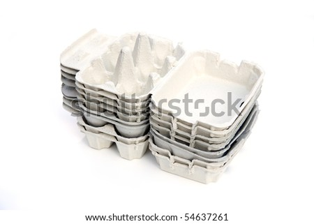 cardboard egg boxes isolated on a white studio background.