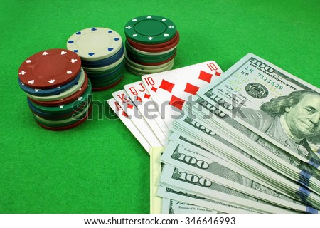 Cards, poker chips and money on cloth