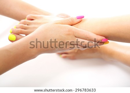 Care treatment, relaxing foot massage. Beautician massaging woman's foot, acupressure treatment