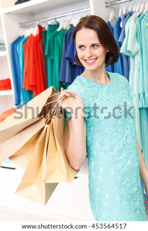 Carefree girl shopping in store