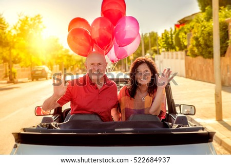 carefree retirement couple driving to long journey
