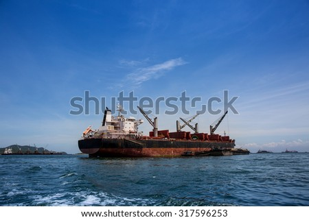 Cargo ship waiting to dock in the sea.