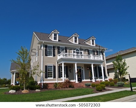 CARMEL, INDIANA - MAY 9, 2014:  New Construction large two-story tan home styled to look like an historic house.