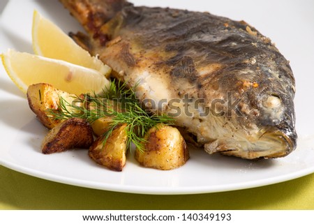 Carp baked with vegetables