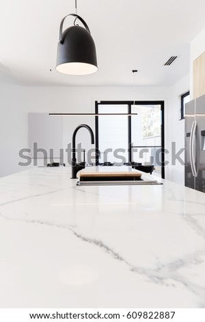 Carrera Marble Benchtop With Black Goose Neck Kitchen Tap And Black Pendant  Light