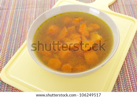Carrot vegetable soup with carrot pieces