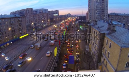 Cars ride at Gavrikova Street (Third Ring Road) at evening in Moscow, Russia. Aerial view
