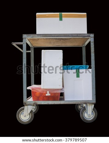 Cart load white foam box with red basket isolated on black background, with clipping path
